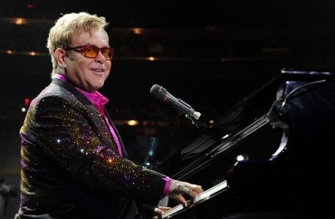 NEW YORK, NY - DECEMBER 04:  Elton John performs at Madison Square Garden on December 4, 2013 in New York City.  (Photo by Kevin Mazur/WireImage)