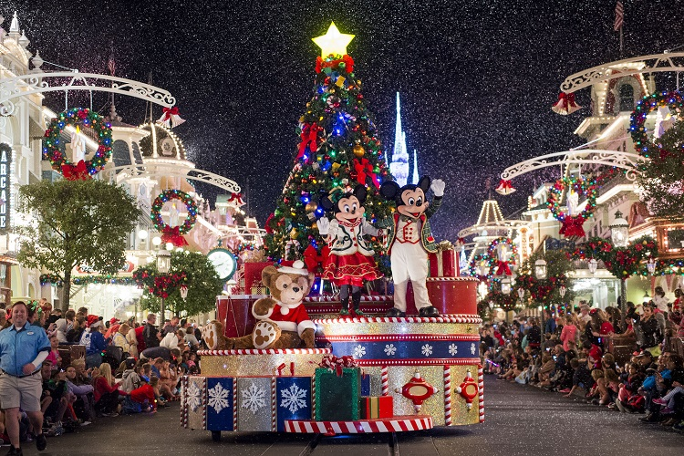 """Mickey Mouse, Minnie Mouse and Duffy wave to Magic Kingdom guests as snow falls on Main Street, U.S.A., during """" Mickey's Once Upon a Christmastime Parade"""" at Walt Disney World Resort. The festive processional is one of the happy highlights of Mickey's Very Merry Christmas Party, a night of holiday splendor with lively stage shows, a unique holiday parade, Holiday Wishes: Celebrate the Spirit of the Season nighttime fireworks, and snow flurries on Main Street, U.S.A. The special-ticket event takes place on select nights in November and December at Magic Kingdom in Lake Buena Vista, Fla. (Ryan Wendler, photographer)"""