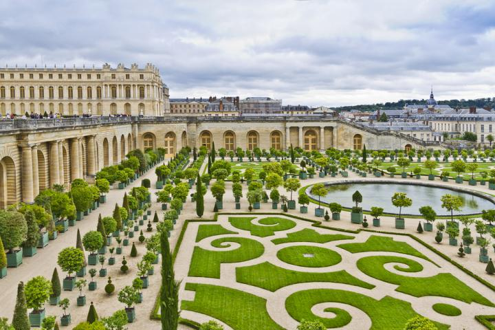 shutterstock_Orangery was designed by Louis Le Vau, it is located south of the Palace Versailles, Paris, France. Versailles was a royal chateau. It was added to the UNESCO list of World Heritage Sites