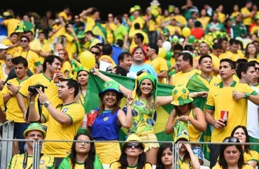 FORTALEZA, BRAZIL - JUNE 17:  Brazil supporters during the 2014 FIFA World Cup Brazil Group A match between Brazil and Mexico at Castelao on June 17, 2014 in Fortaleza, Brazil.  (Photo by Laurence Griffiths/Getty Images for Sony)